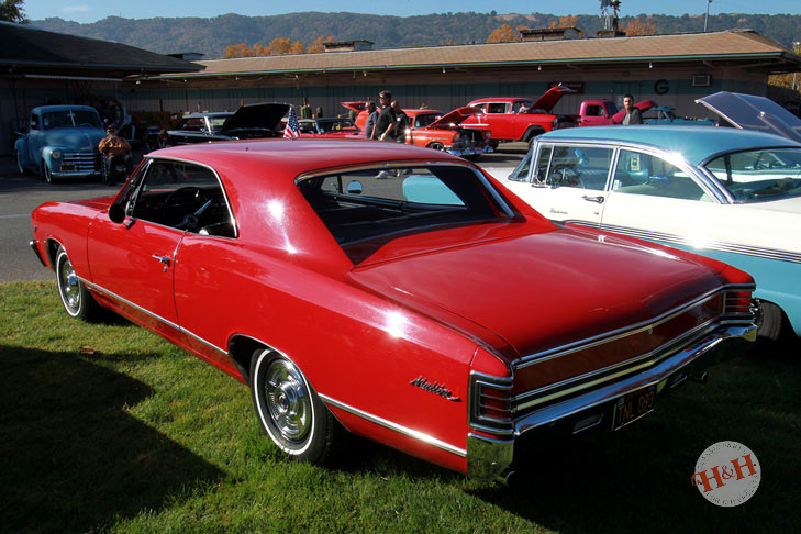 Classic red Malibu with white wall tires